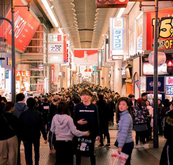 crowd of people walking inside store